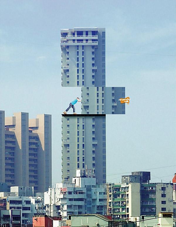 kid pushing chunk of building billboard