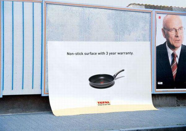 billboard ad sliding off wall tefal nonstick surface