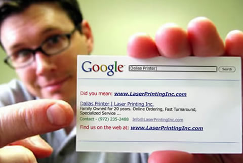 postcard of owner holding business card