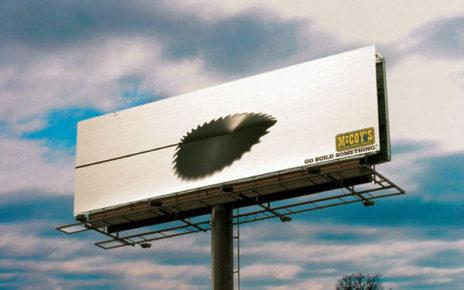 saw blade cutting through billboard