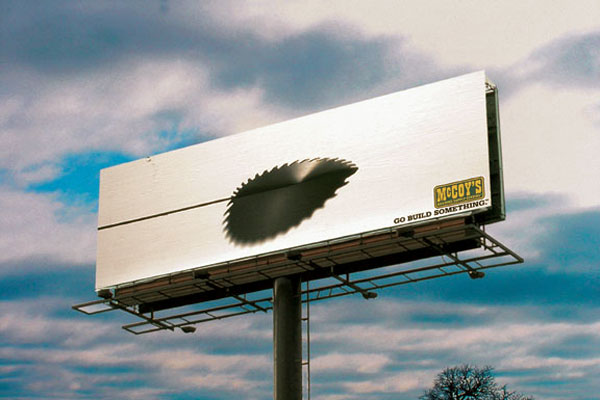 saw blade cutting through billboard