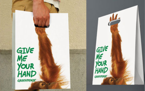 greenpeace guerilla hand reaching up shopping bag