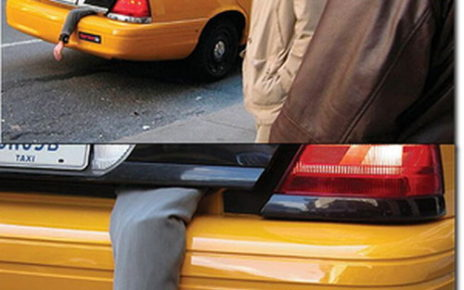 vehicle-advertising sopranos hand out of taxi trunk