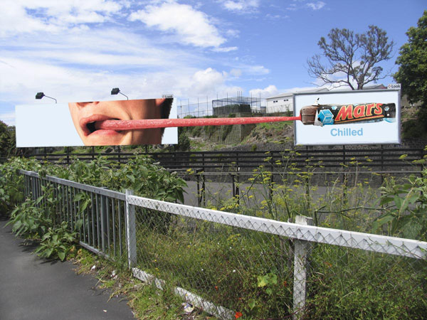 tongue stretching between two billboards chille mars bar