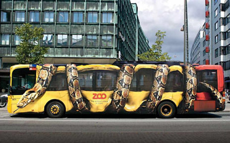 vehicle ad snake wrapped around bus copenhagen zoo