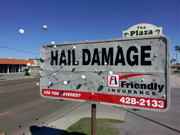 realist road sign for hail damage insurance