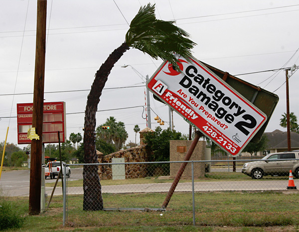 realistic appearing hurricane damage insurance sign