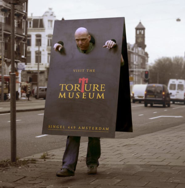 clever sandwich sign marketing for museum of torture