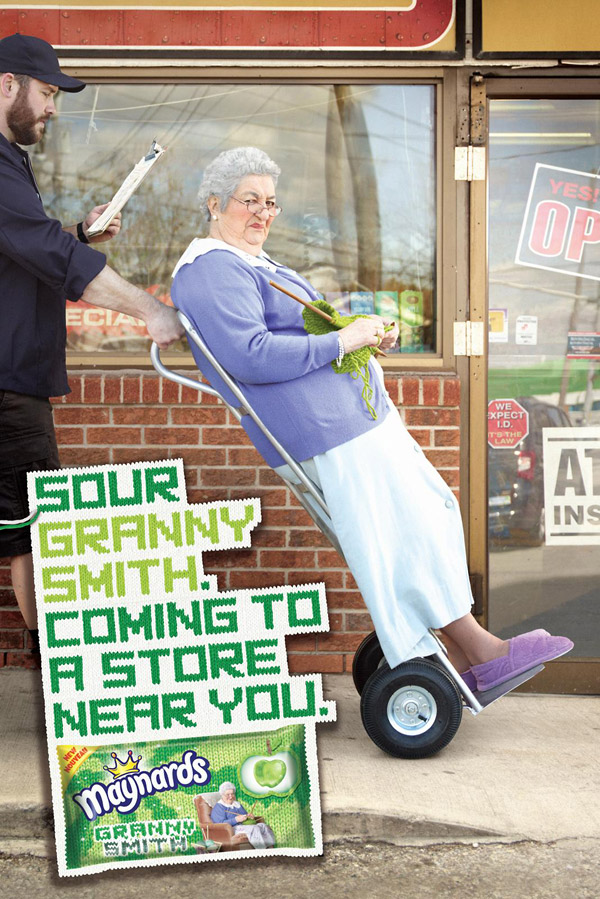 sour granny smith candy on moving hand cart print ad