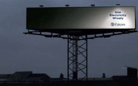 use energy wisely billboard that's only partially illuminated
