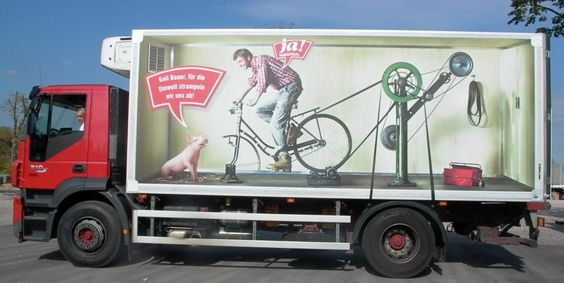 funny truck wrap man talking to pig while riding bike that powers truck