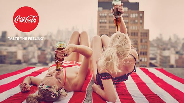 coke taste the feeling print ad girls sunbathing on rooftop