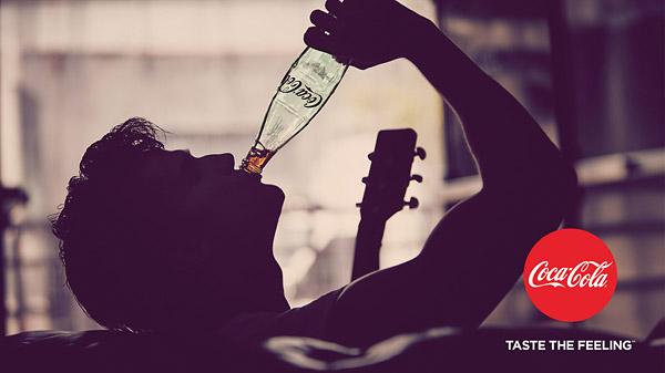 coke taste the feeling print ad male silouette guitar