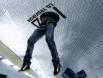 body falling through ceiling billboard marketing