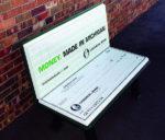 park bench advertising looks like open checkbook