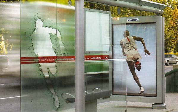 nike man busting through bus shelter glass outdoor advertising