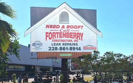 billboard shaped to look like house