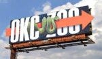 snake crawling across billboard - okc zoo