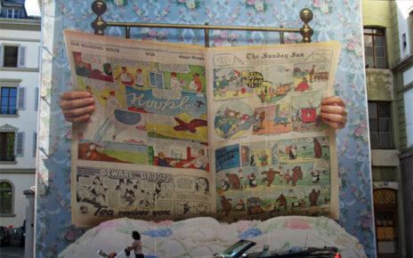 newspaper mural on building swiss art festival