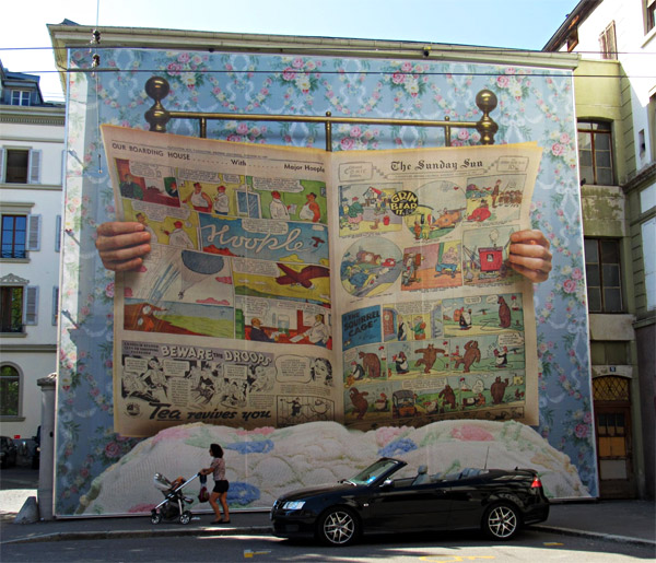 newspaper mural on building swiss art festival
