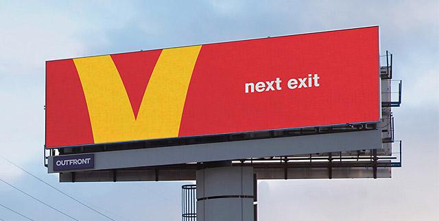 directional billboard mcdonalds next exit