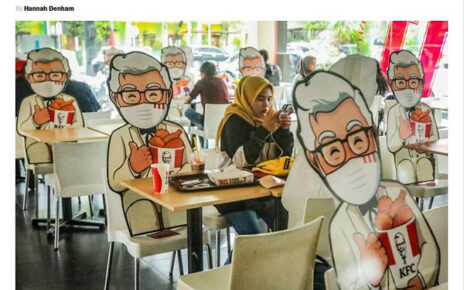 col sanders cutouts maintain social distancing in kfc restaurants
